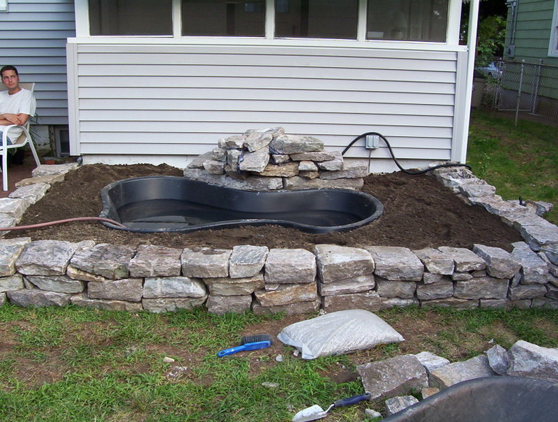 Diy backyard koi pond images for Cheap pond ideas