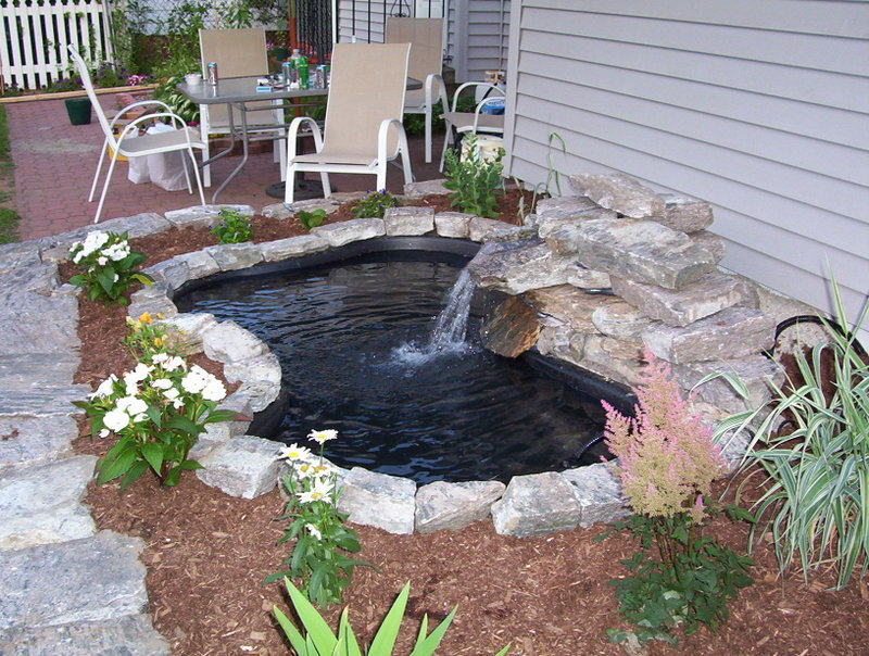 Relaxing diy outdoor ponds home design elements for Diy waterfall pond ideas